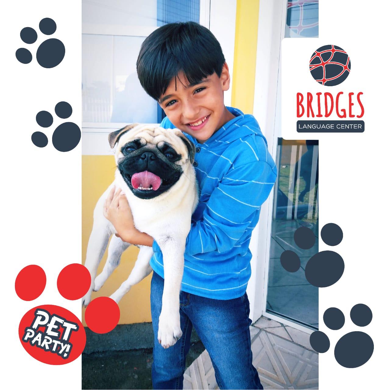Bernardo com seu cachorro na Pet Party (Festa dos Animais de Estimação), promovida pela Bridges